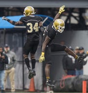 Alabama State cornerback Dennis Roberts IV (3) and  defensive back Devon Booker (34) celebrate stopping Alabama A&M on fourth down with a pass breakup in the end zone during the Magic City Classic at Legion Field in Birmingham, Ala. on Saturday October 27, 2017.