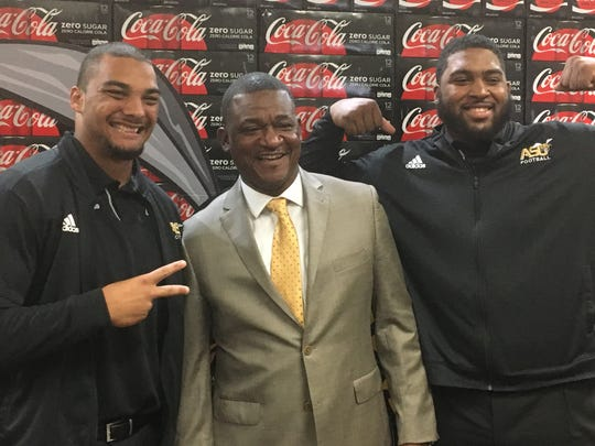 From left: Alabama State defensive lineman Devin Santana, head coach Donald Hill-Eley and offensive lineman Tytus Howard.