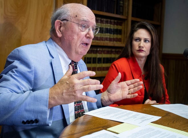 Attorneys Julian McPhillips, left, and Melissa Isaak, right, speak during a press conference, in Montgomery, Ala., on Thursday October 25, 2018, announcing a complaint about Attorney General Steve Marshall's acceptance of money from the Republican Attorneys General Association.