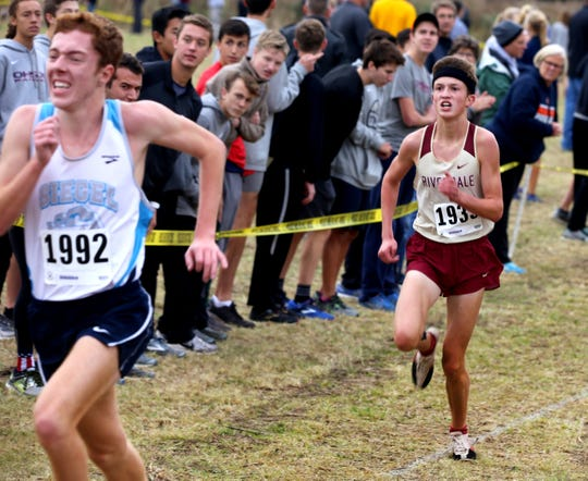 Siegel's Seth Robinson (left) and Riverdale's Eli Cramer compete in the Region 4 Large meet earlier this season.