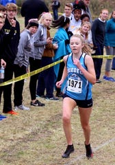 Ella Phillips of Siegel  runs in the Region 4 Large cross country championships, at Cedars of Lebanon State Park, on Thursday, Oct. 25, 2018.
