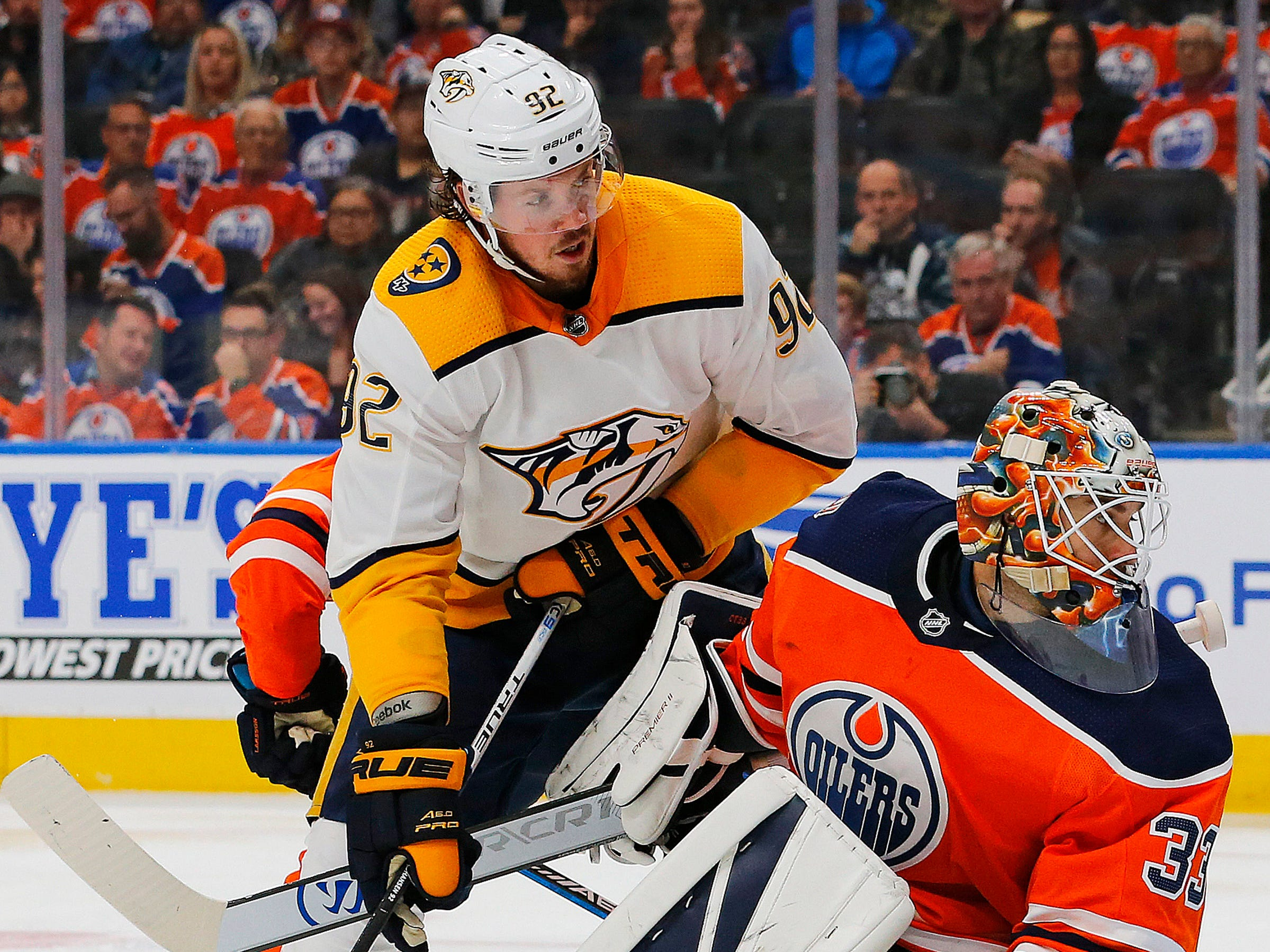 Nashville Predators forward Ryan Johansen (92) and Edmonton Oilers goaltender Cam Talbot (33) watch the puck during the second period at Rogers Place.