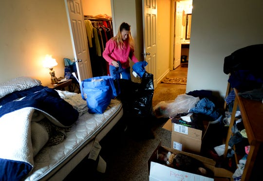 Kim Byrd packs up belongings she and James Rushing own in their Park West apartment on Thursday, Oct. 25, 2018, in Nashville, Tenn. They were homeless until four years ago when Open Table helped them get their apartment. James is terminally ill with cancer.