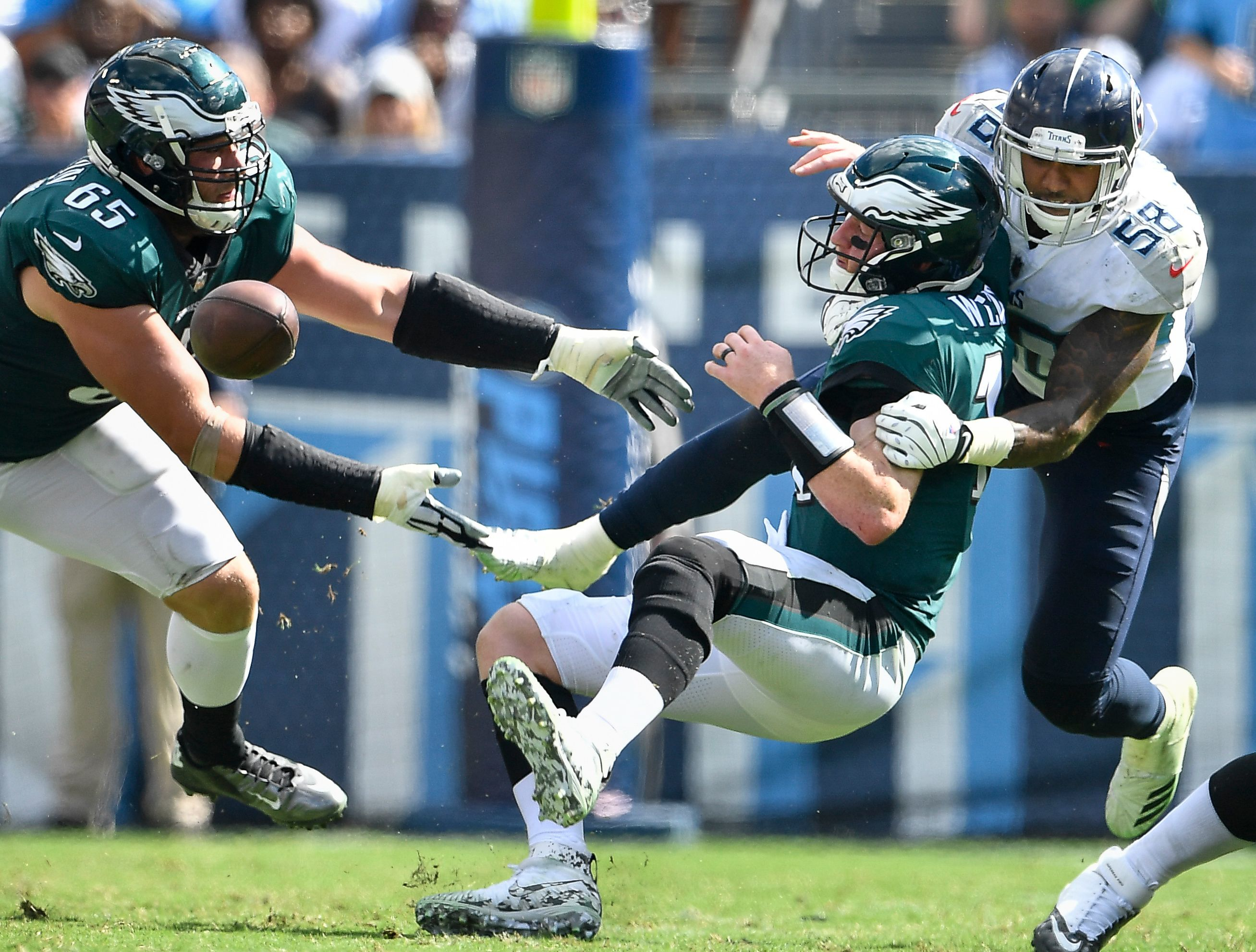 Titans linebacker Harold Landry (58) forces Eagles quarterback Carson Wentz (11) to fumble as he is sacked during the fourth quarter Sunday.