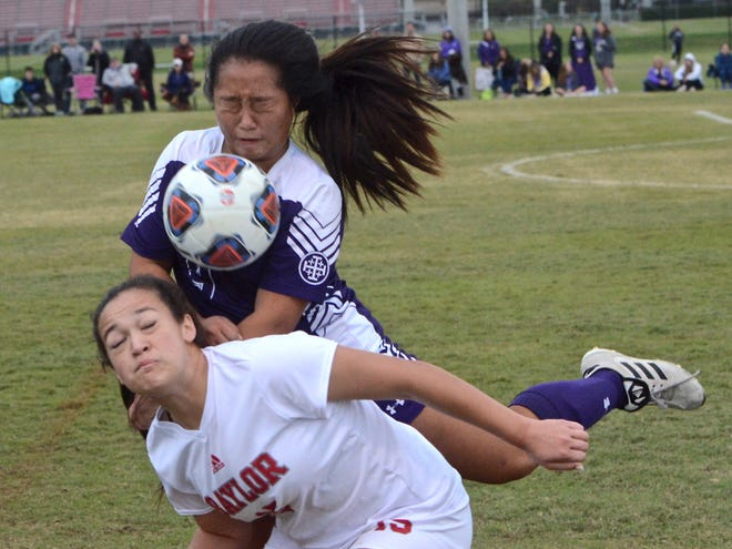 Father Ryan's Minsaw Kwak (9) battles for a header against Baylor's Mya Mgee (15) during Thursday's Division II-AA semifinal match.