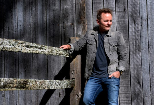 Christian singer Chris Tomlin stands at his historic home and barn Wednesday, Oct. 24, 2018, in Franklin. Tomlin, who released a new album last year and is launching a tour, is the only Christian artist to surpass 1.5 billion streams.