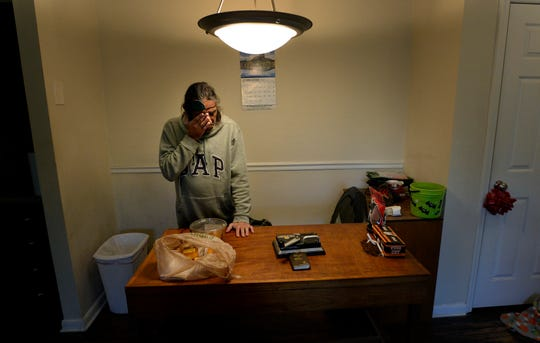 James Rushing rubs his eye where his cancer has spread as he stands in the kitchen of his Park West apartment on Thursday, Oct. 25, 2018, in Nashville, Tenn. Kim Byrd and Rushing were homeless until four years ago when Open Table helped them get their apartment. James is terminally ill with cancer.