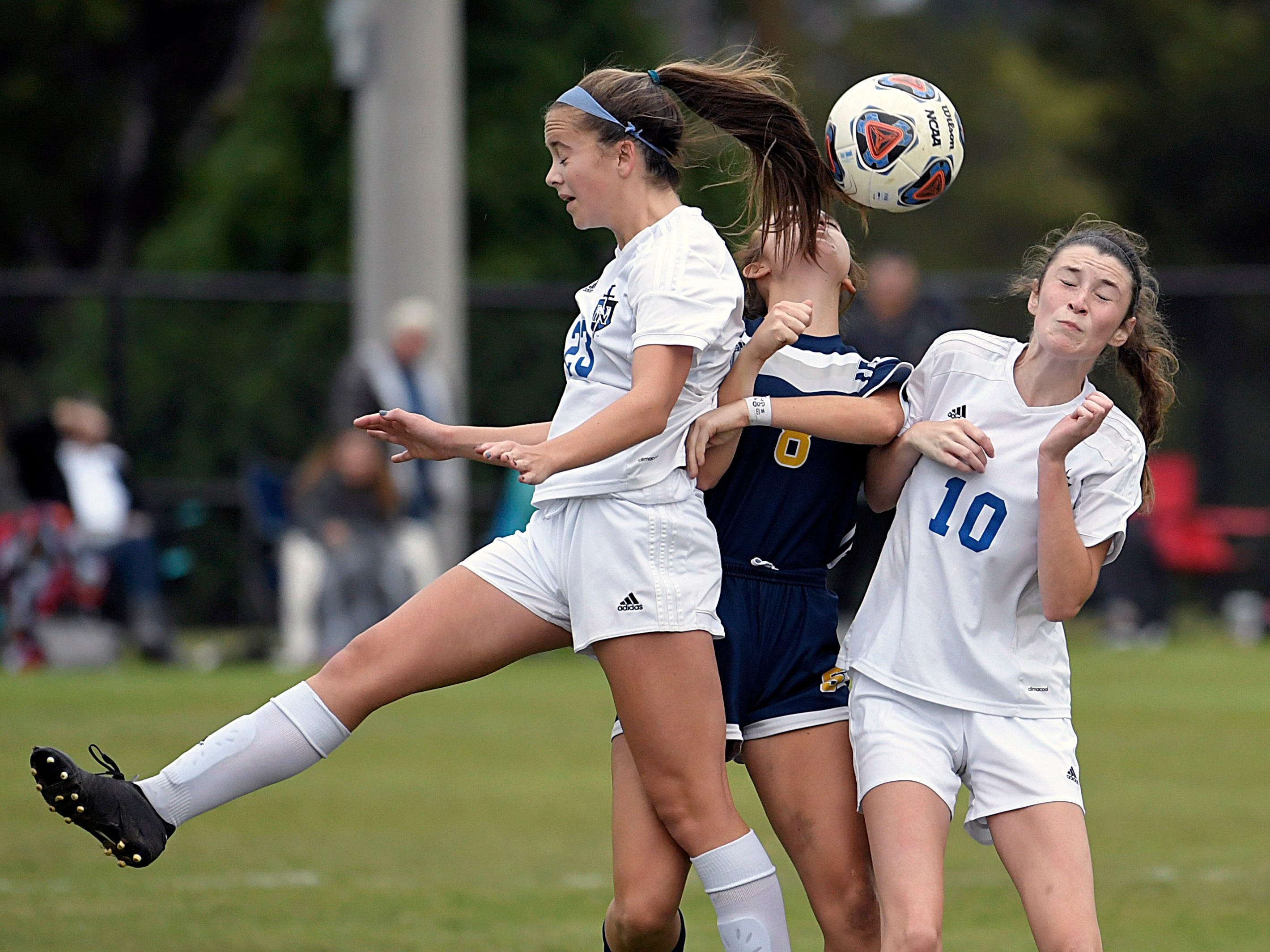 Seymour player Abbie Biddle (8) tries to head the ball with Nolensville players Kaitlyn Sneed  (23) and Waverly Dickason (10) during a semifinal game at the TSSAA Class AA State Girls' Soccer Tournament in Murfreesboro on Thursday, Oct. 25, 2018.