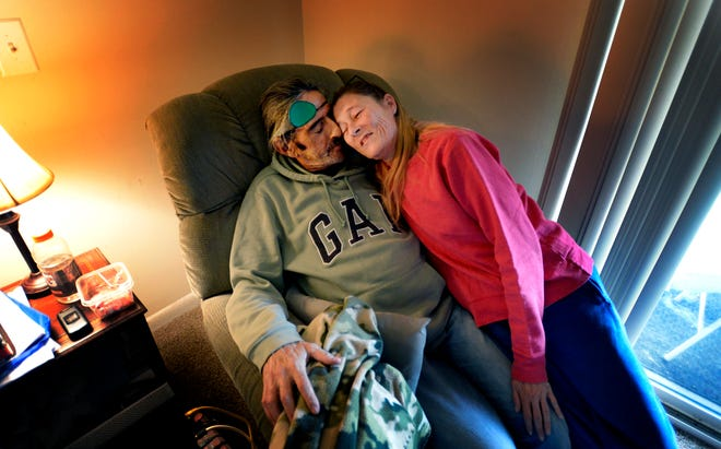 Kim Byrd and James Rushing spend a moment together at their Park West apartment on Thursday, Oct. 25, 2018, in Nashville, Tenn. They were homeless until four years ago when Open Table helped them get their apartment. James is terminally ill with cancer.