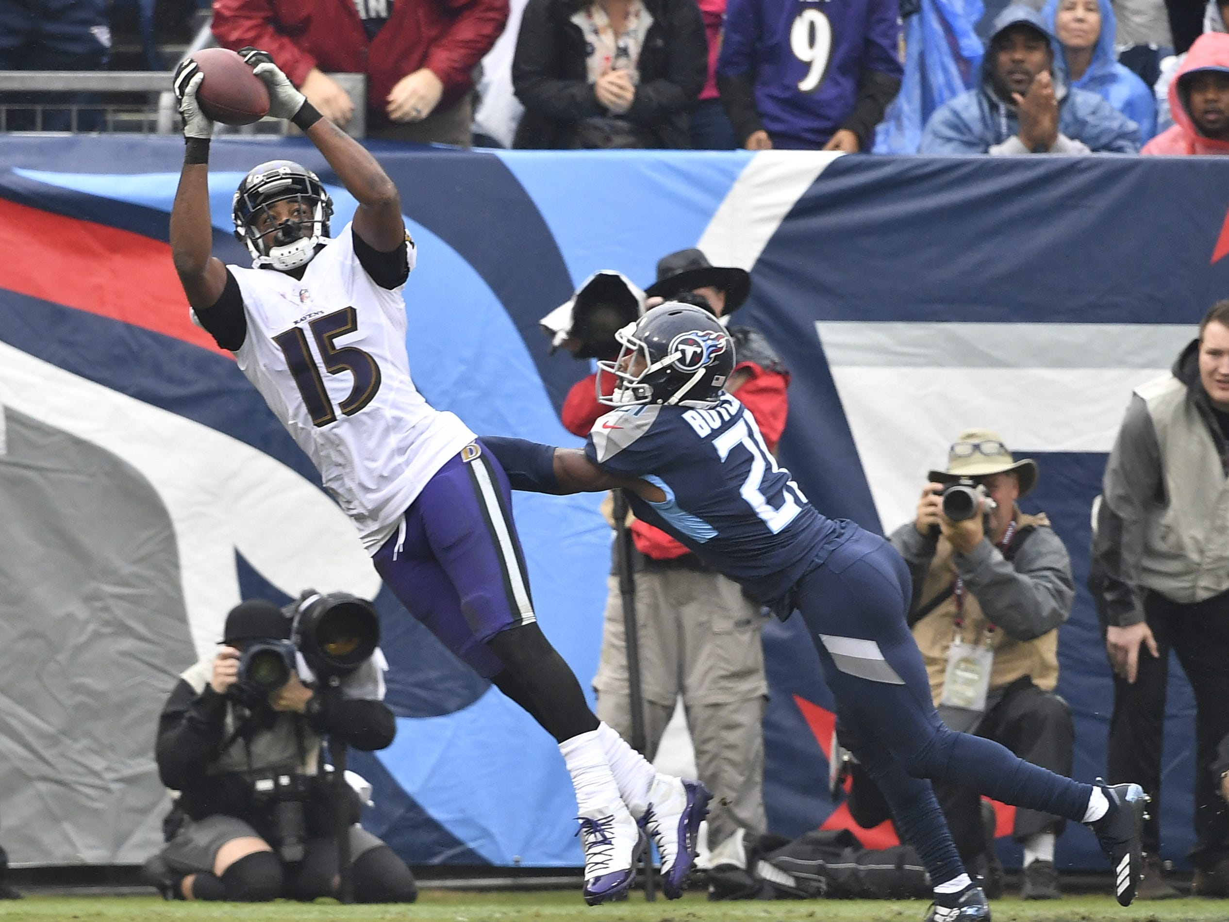 Ravens wide receiver Michael Crabtree (15) pulls in a touchdown catch over Titans cornerback Malcolm Butler (21) in the first quarterat Nissan Stadium Sunday, Oct. 14, 2018, in Nashville, Tenn.