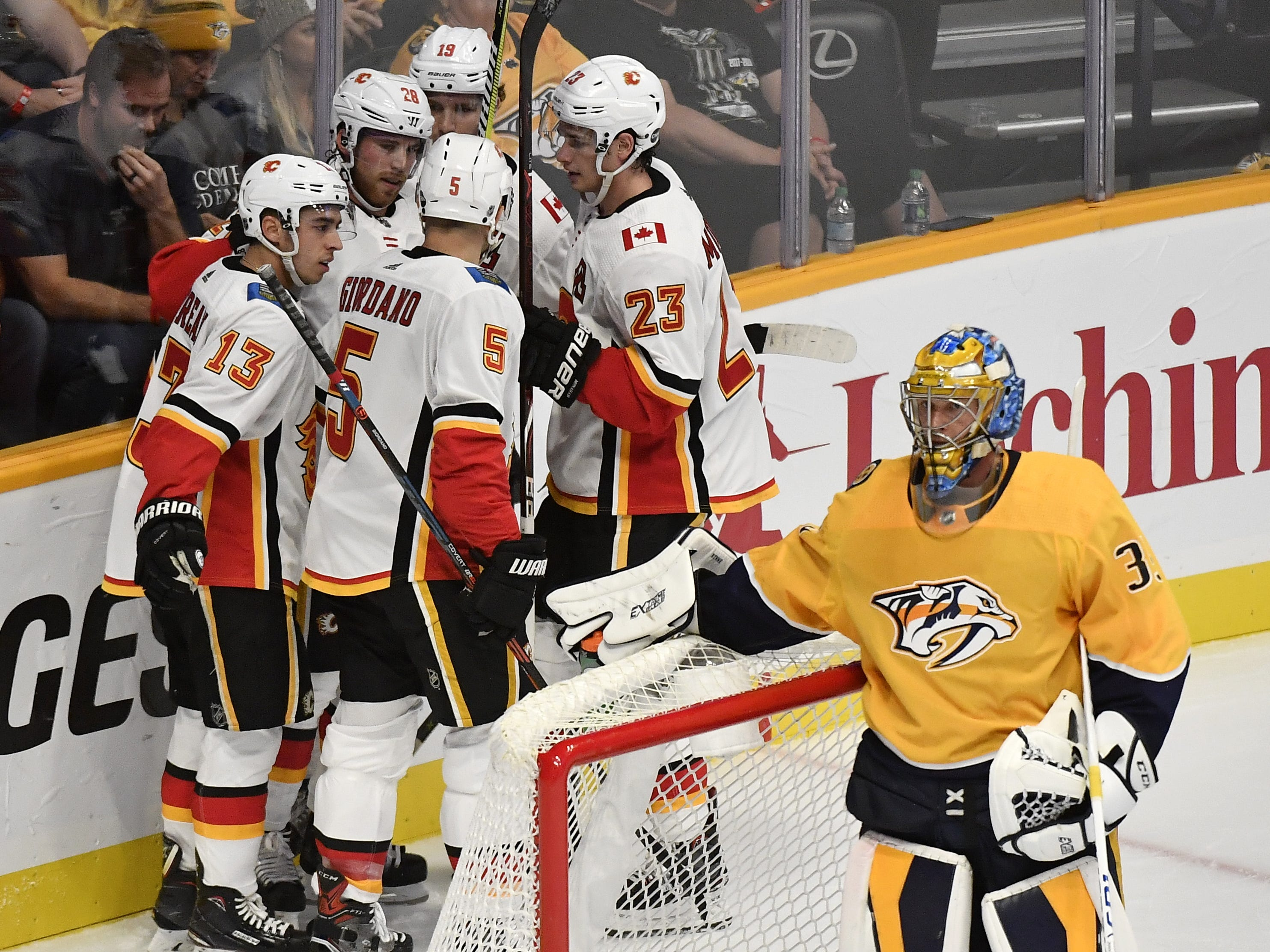 Oct. 9: Flames 3, Preds 0: The Flames celebrate the goal by center Elias Lindholm (28) behind Nashville Predators goaltender Pekka Rinne (35) in the first period of the home opener at Bridgestone Arena in Nashville, Tenn., Tuesday, Oct. 9, 2018.