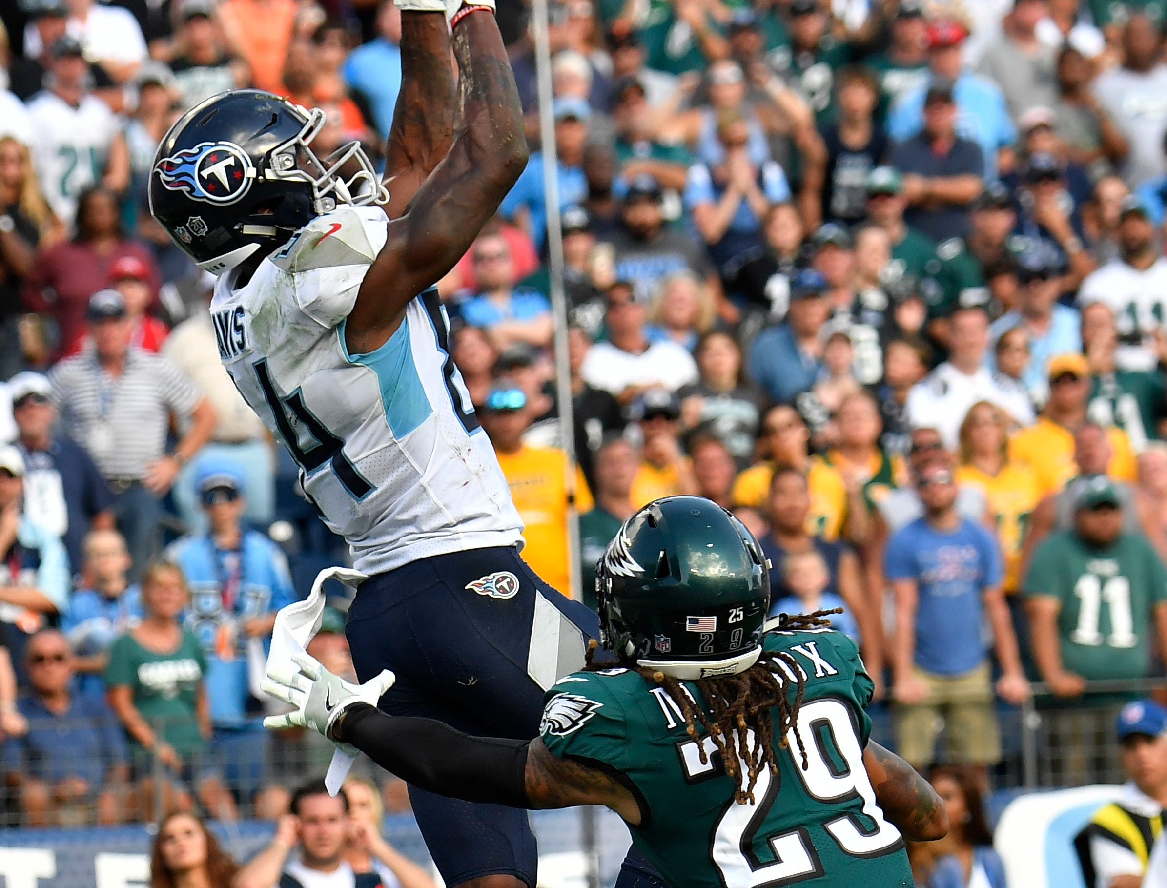 Titans wide receiver Corey Davis (84) makes the game-winning touchdown over Eagles cornerback Avonte Maddox (29) in overtime at Nissan Stadium Sunday, Sept. 30, 2018, in Nashville, Tenn.