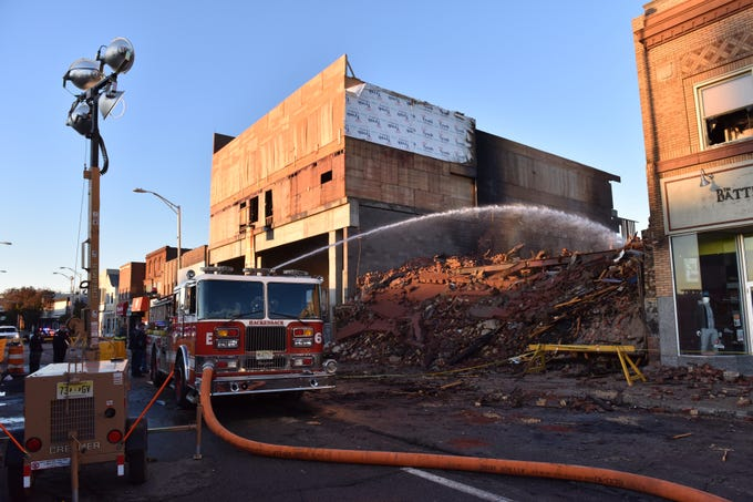 The morning after the fire in downtown Hackensack, water is still being poured on the furniture store on Thursday morning October 25, 2018.