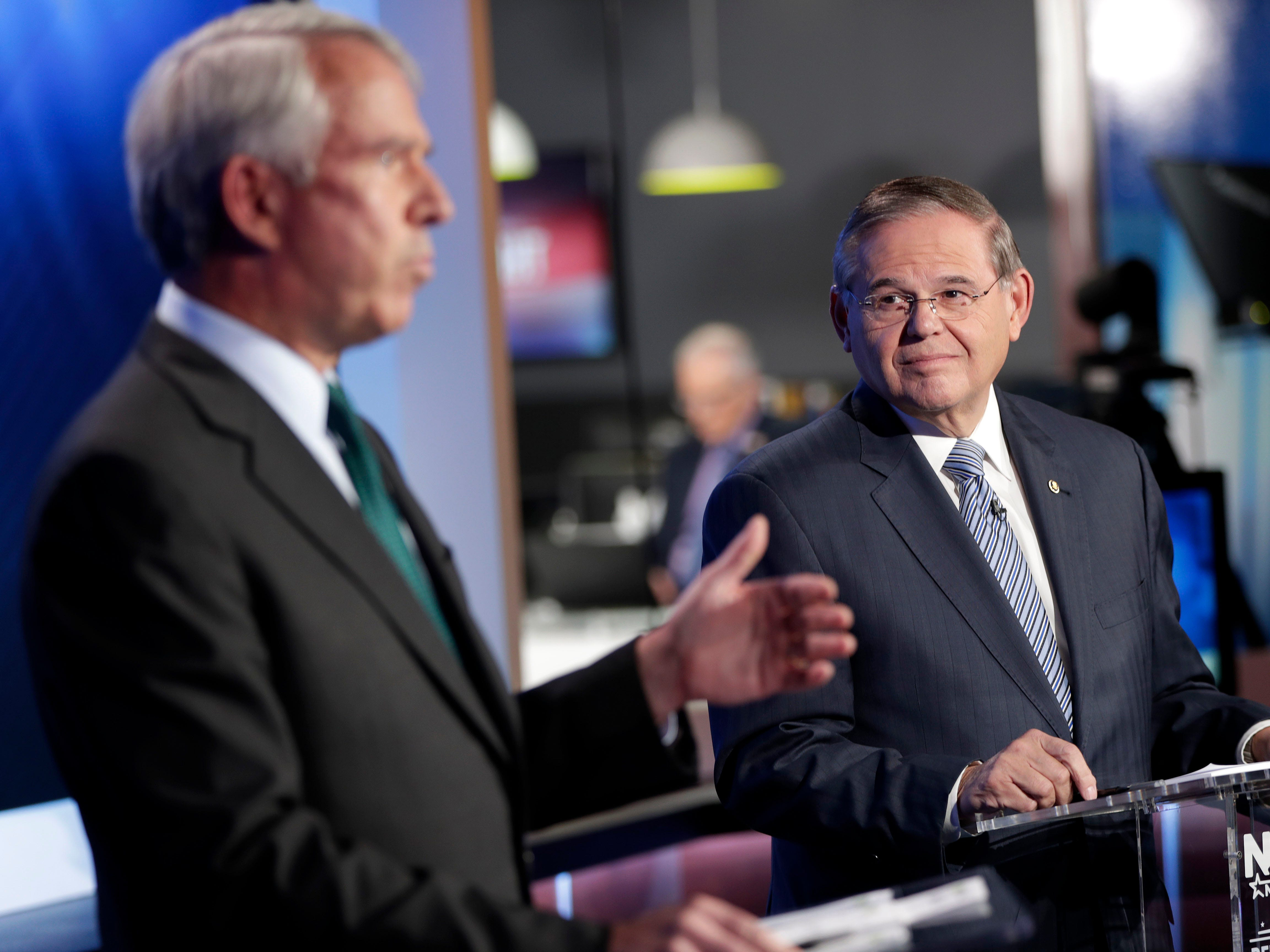 New Jersey Sen. Bob Menendez, right, the Democrat candidate for the U.S. Senate race in New Jersey, looks on as Bob Hugin, the Republican candidate, answers a question during a debate, Wednesday, Oct. 24, 2018, in Newark, N.J.