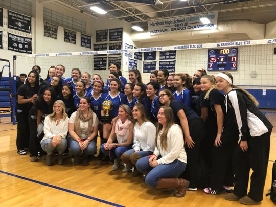 Wood-Ridge players and coaches gather to celebrate the Blue Devils' NJIC girls volleyball tournament championship on Wednesday, Oct. 24, 2018 in Harrison.