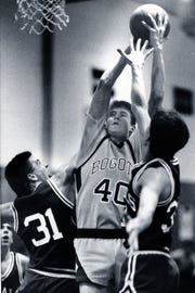 Pat Sullivan takes a shot while playing for Bogota in 1989. Sullivan is now an assistant coach for the New York Knicks.