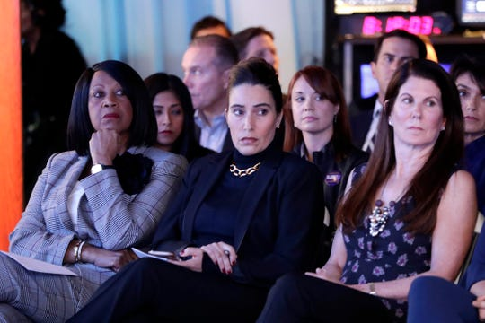 New Jersey Lt. Gov. Sheila Oliver, left, sits with New Jersey Senate President Pro Tempore Teresa Ruiz (D-Newark), center, and Kathy Hugin, wife of U.S. Senatorial Republican candidate Bob Hugin, as they attend a debate between Bob Hugin and U.S. Sen. Bob Menendez, Wednesday, Oct. 24, 2018, in Newark, N.J.