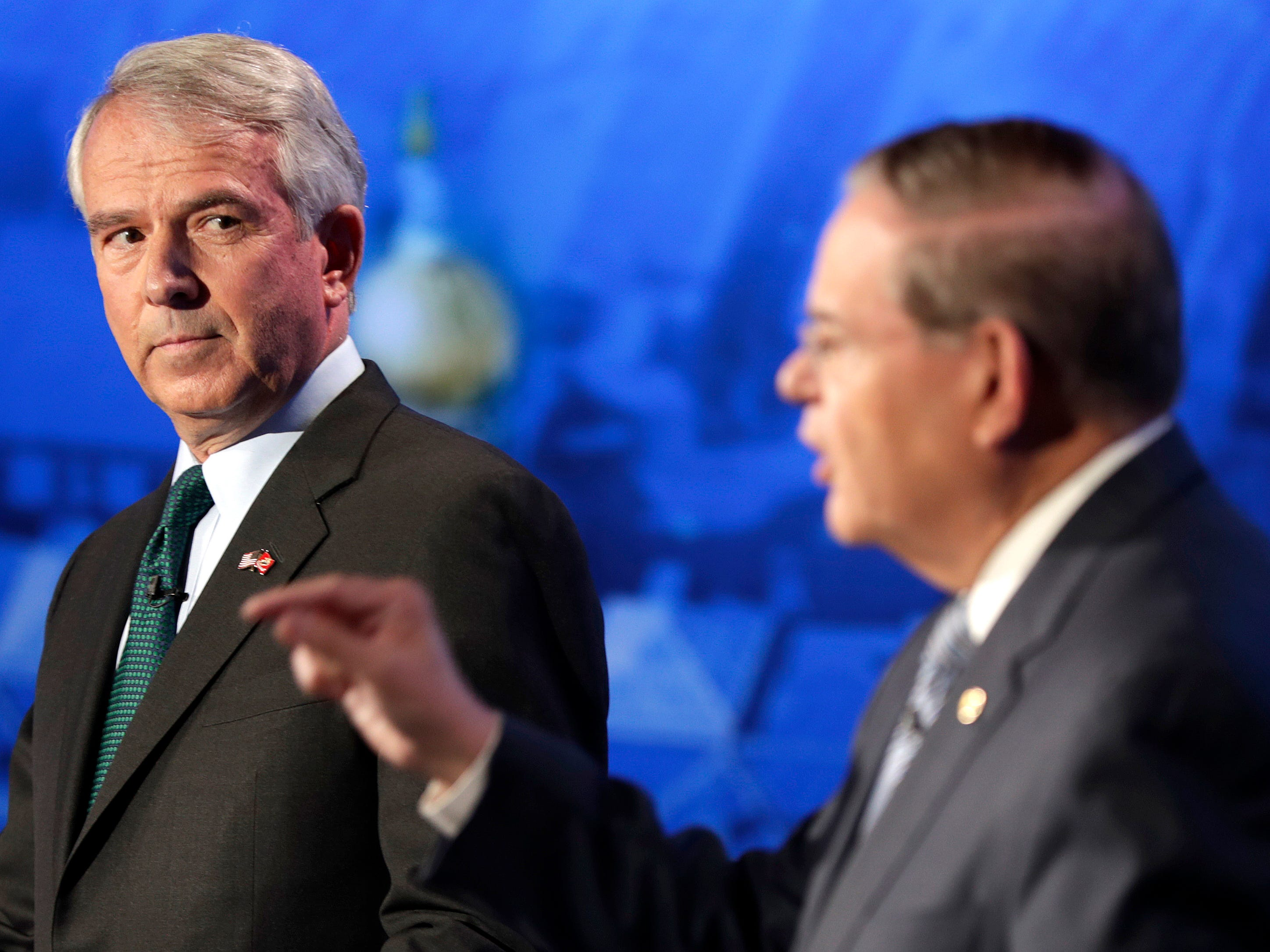 Bob Hugin, left, the Republican candidate for the U.S. Senate race in New Jersey, looks on as Sen. Bob Menendez, the Democrat candidate, speaks during a debate, Wednesday, Oct. 24, 2018, in Newark, N.J.
