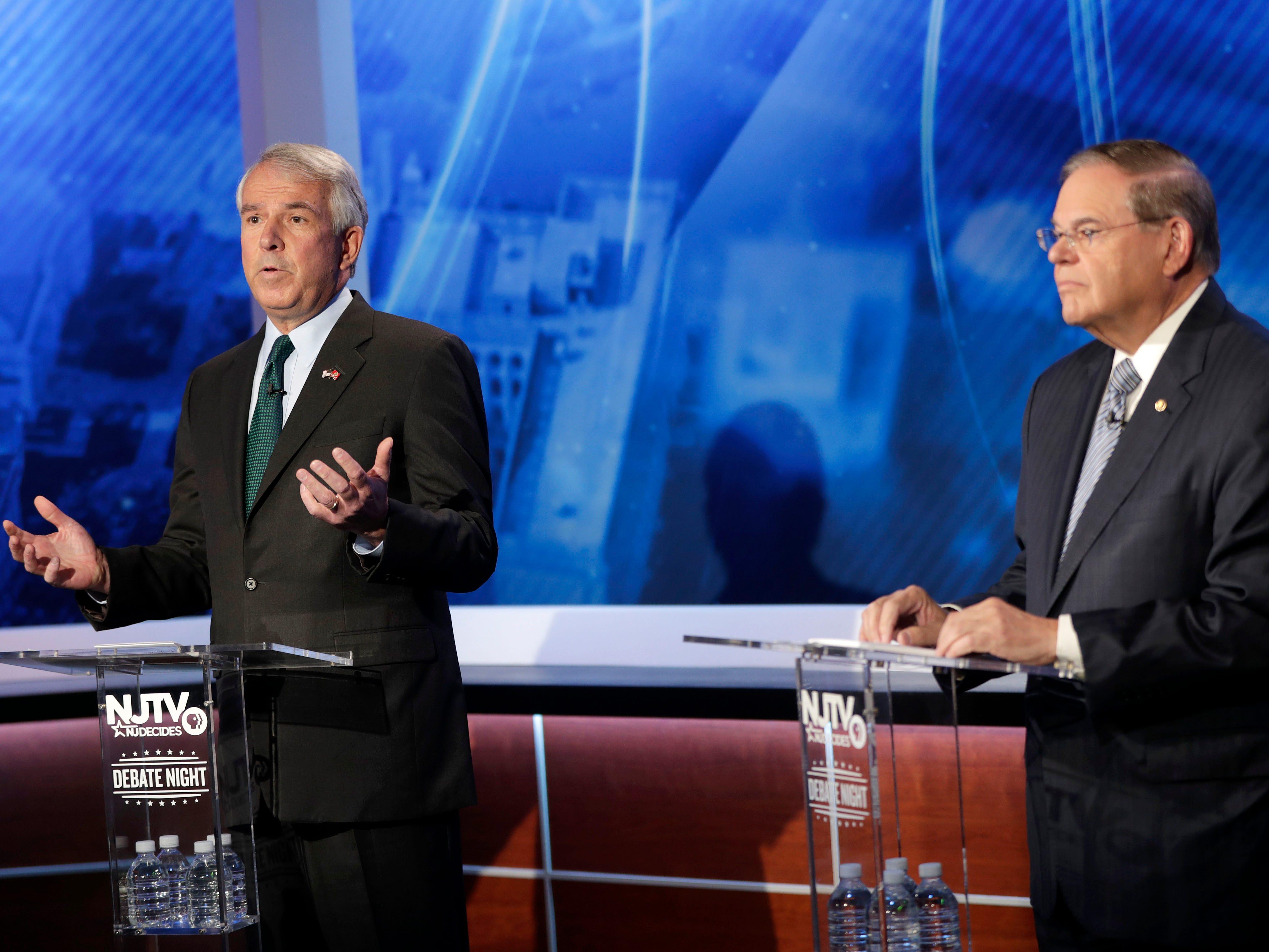 Bob Hugin, left, the Republican candidate for the U.S. Senate race in New Jersey, speaks during debate with Sen. Bob Menendez, the Democrat candidate, Wednesday, Oct. 24, 2018, in Newark, N.J.