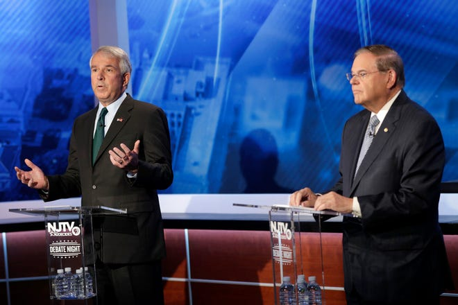 Bob Hugin, left, the Republican candidate for the U.S. Senate race in New Jersey, speaks during debate with Sen. Bob Menendez, the Democrat candidate, Wednesday, Oct. 24, 2018, in Newark, N.J.