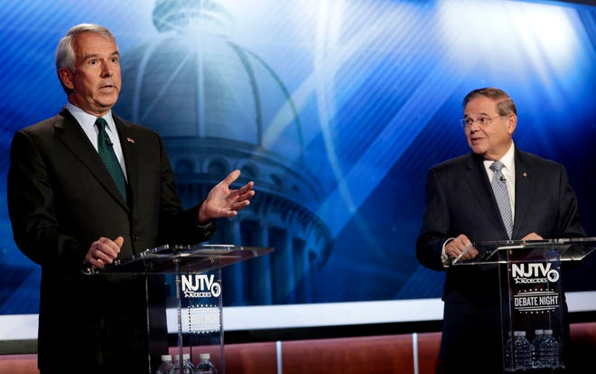 Bob Hugin, left, the Republican candidate for the U.S. Senate race in New Jersey, speaks during a debate with Sen. Bob Menendez, the Democratic candidate, on Wednesday, Oct. 24, 2018, in Newark.