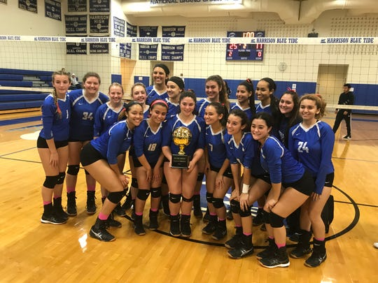 The Wood-Ridge girls volleyball team with the 2018 NJIC Tournament trophy. From Wednesday, Oct. 24, 2018.