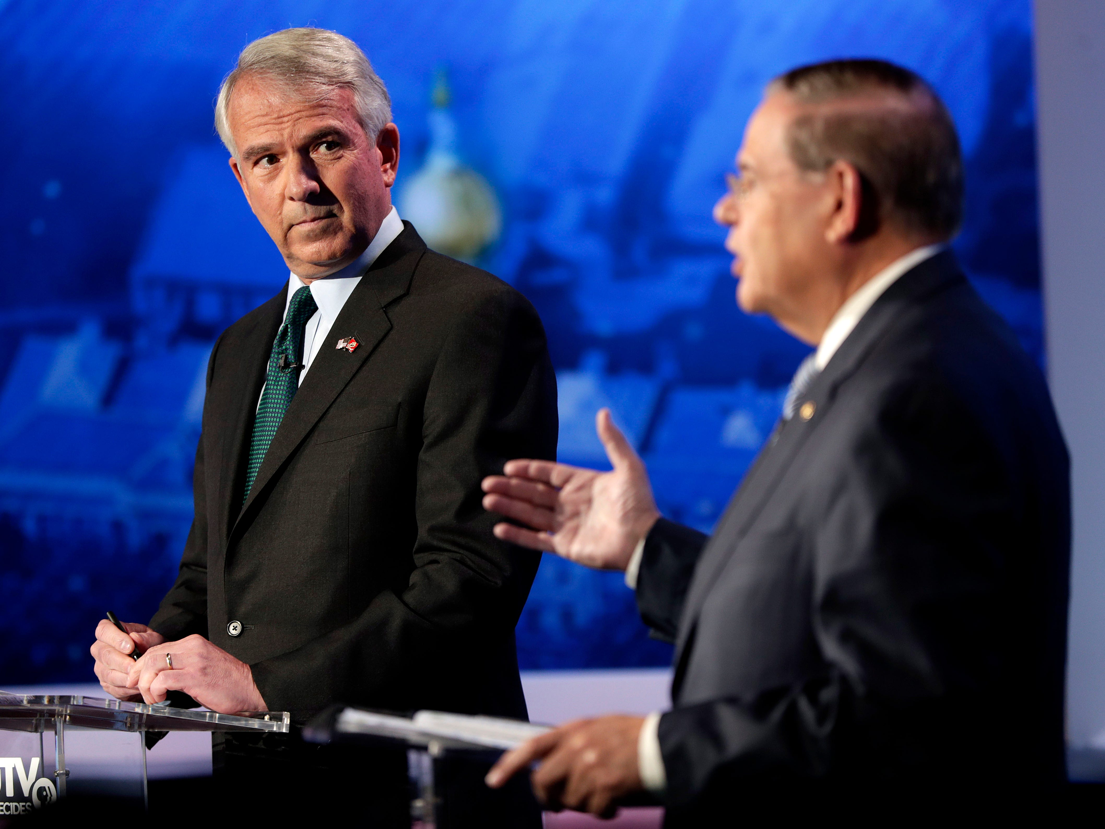 Bob Hugin, left, the Republican candidate for the U.S. Senate race in New Jersey, looks on as New Jersey Sen. Bob Menendez, right, the Democrat candidate, answers a question during a debate, Wednesday, Oct. 24, 2018, in Newark, N.J.