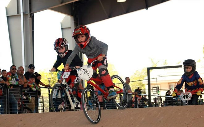 Bike, helmet, shoes, pants, long sleeve, and you can be a BMX rider.