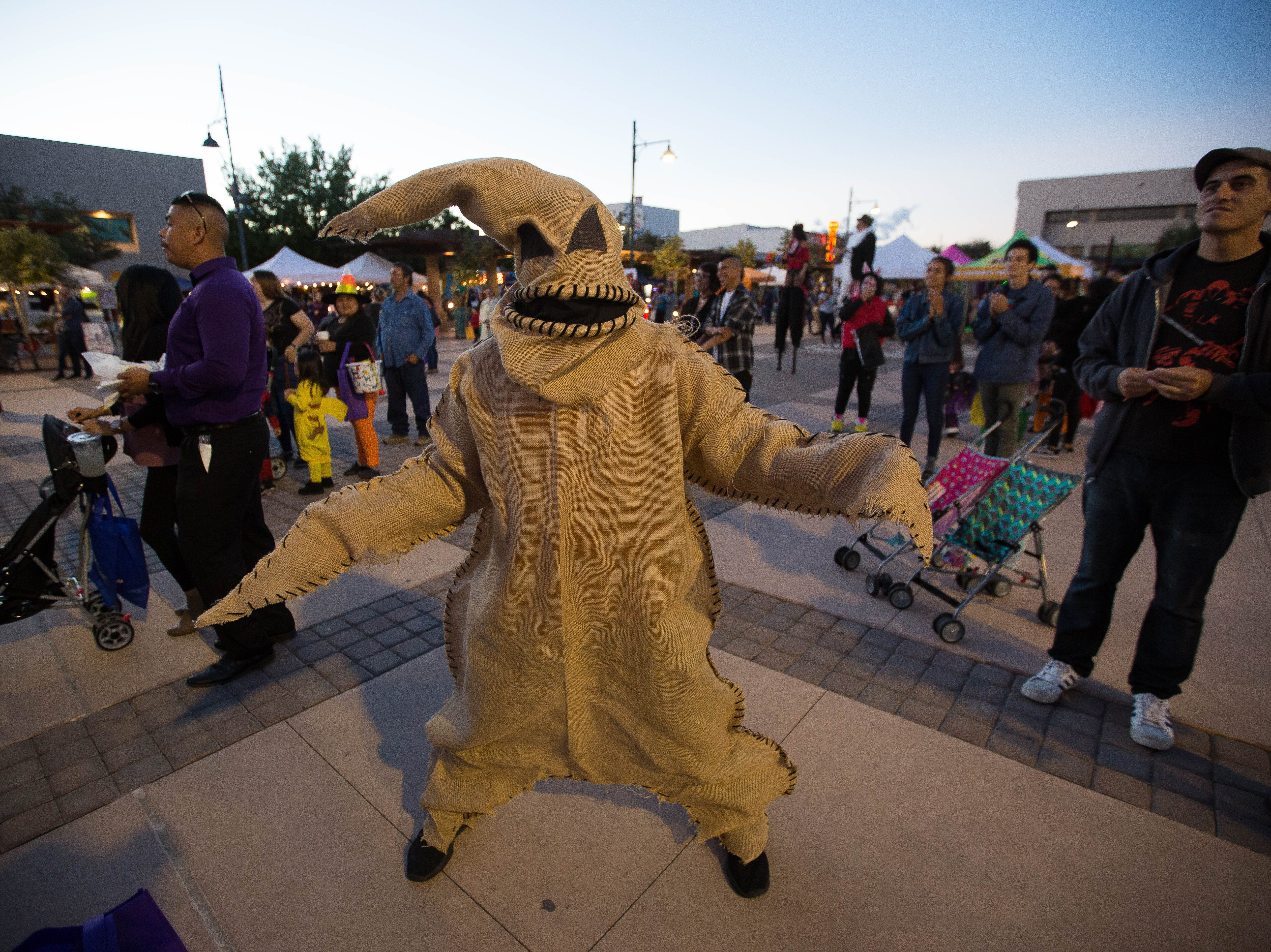 Patrick Martinez, dressed as Oogie Boogie from Nightmare before Christmas, waits for the adult costume contest to start at the Farmers Market Fall Festival, Wednesday October 24, 2018.