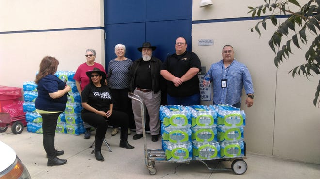 Pictured are: Judith Baca, program coordinator for the Las Cruces Police Department/Victim's Assistance Unit;Deborah Rodgers;Annie Mitchell; Sharon Ewing; Darrell Rodgers; Cory Weiland, president of the Police Officer's Associationand Richard Hernandez of the LCPD.