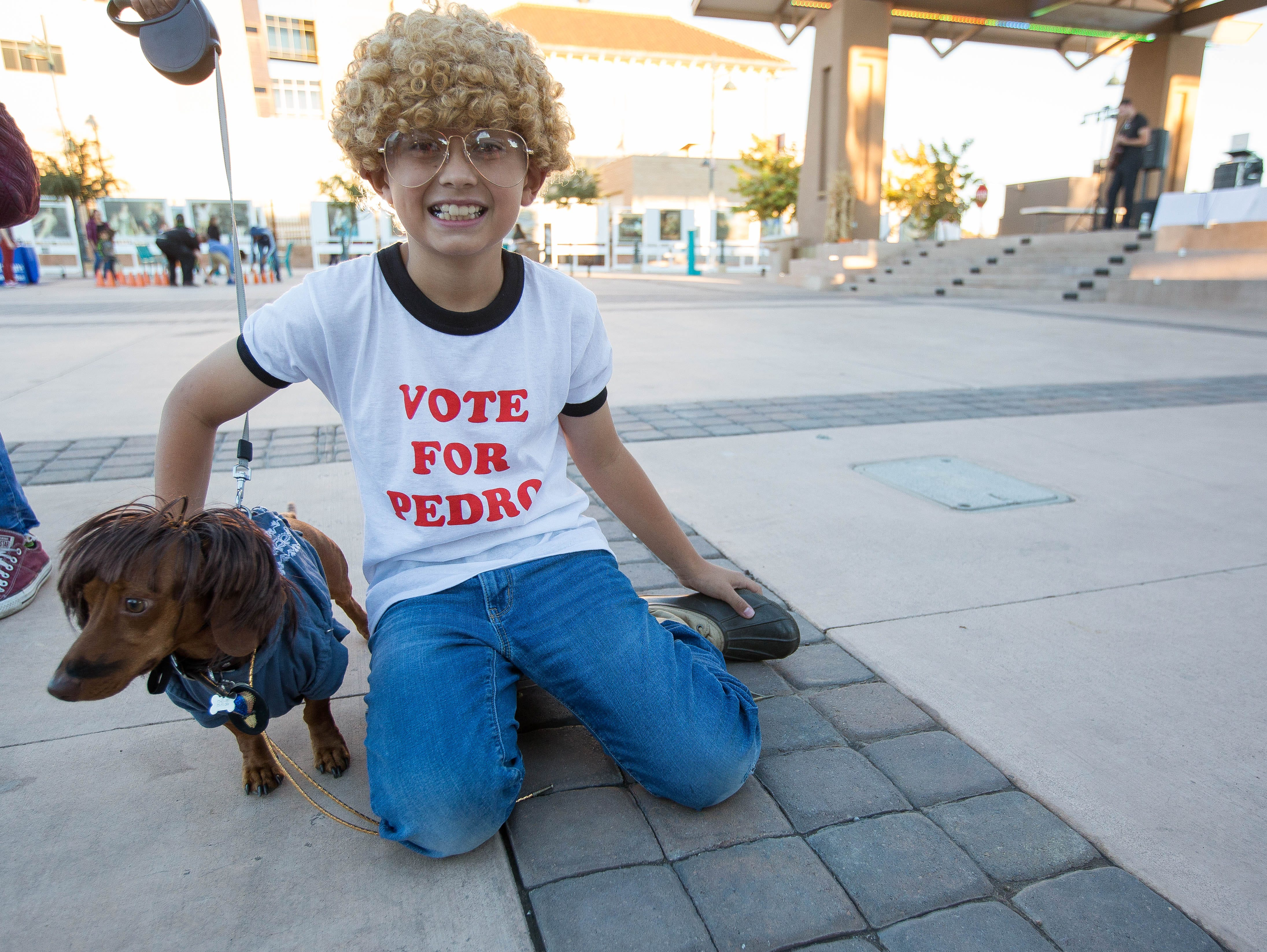 Alex Trujillo, 9, and Copper, dressed as Napoleon Dynamite and Pedro, at the Farmers Market Fall Festival, Wednesday October 24, 2018.