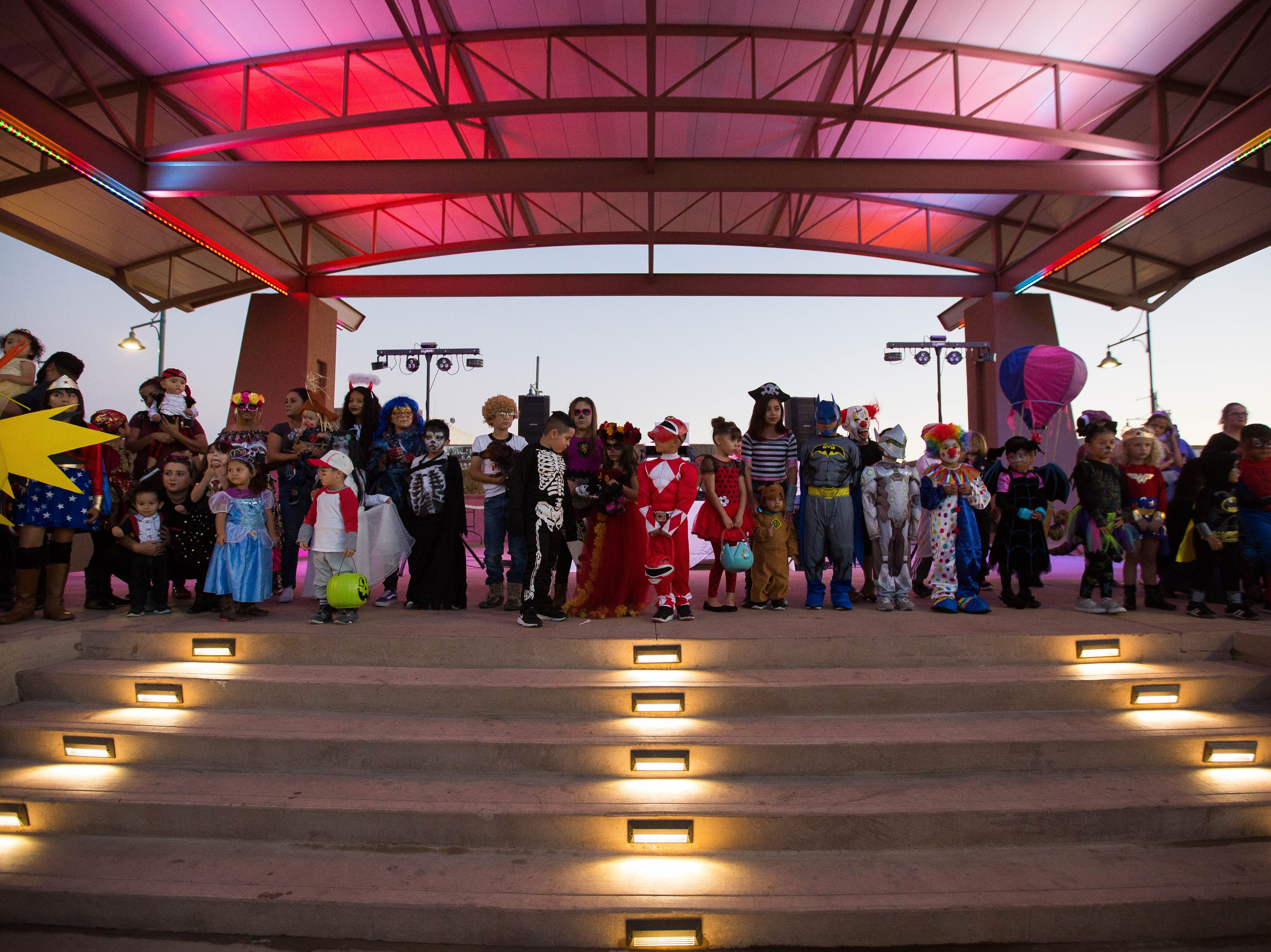 Costumed kids gathered on the stage of the Plaza de Las Cruces for the costume contest during the Farmers Markets Fall Festival, Wednesday October 24, 2018.