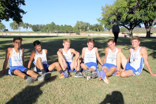 The Cavemen pose following Thursday's Predistrict race at the Carlsbad Beach.
