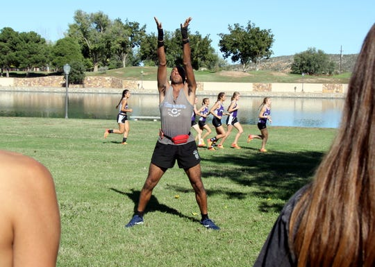 CHS assistant track coach Terrance Orgain goes through a Pikachu warmup during cross-country season. He will be on of the 130 participants in Saturday's Area IV Special Olympic Summer Games at Carlsbad High.