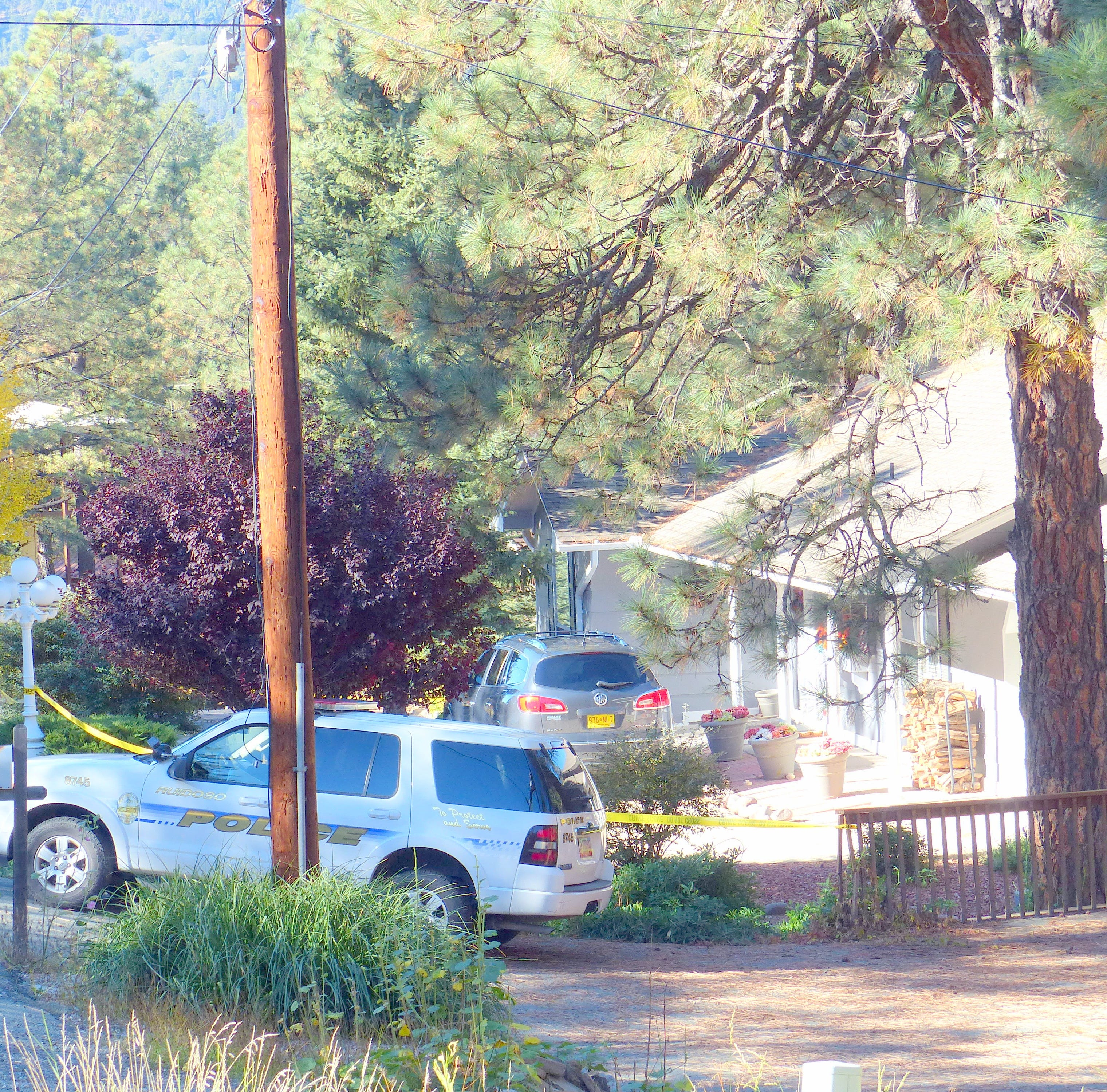 A police patrol car was stationed outside the home on Country Club Drive.