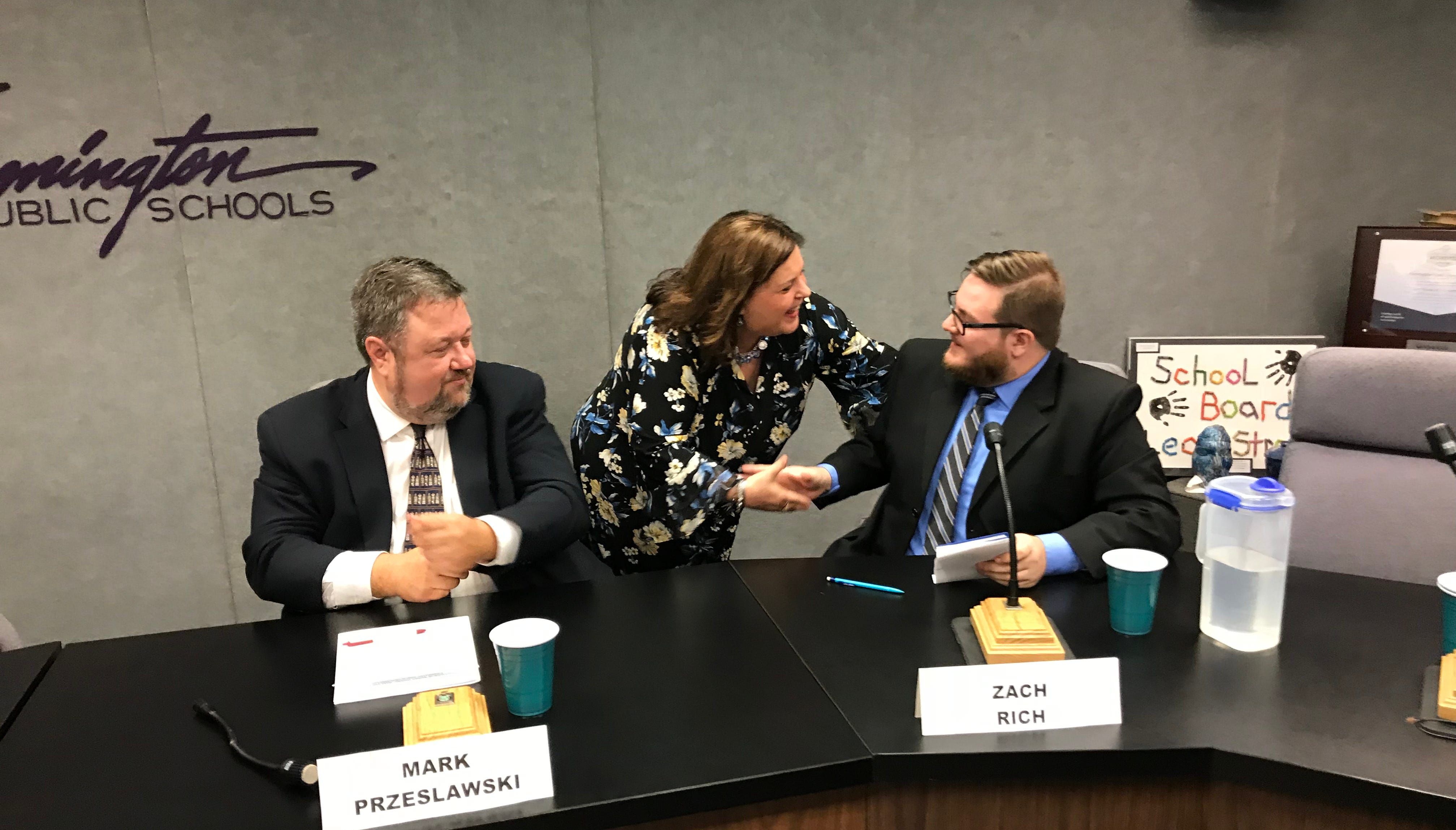 Pamela Green shakes hands with fellow school board candidates Zach Rich (right) and Mark Przeslawski following Tuesday's Farmington school board candidate forum.