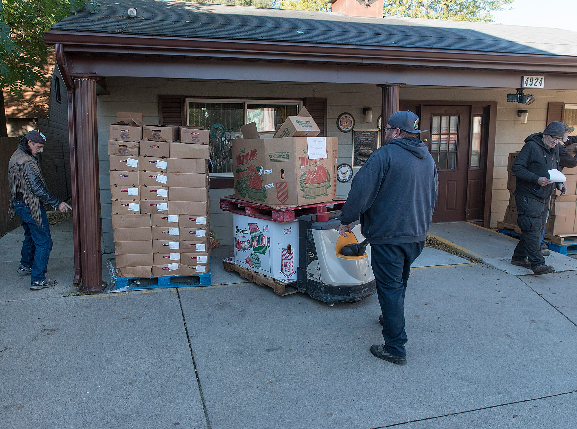 Food from Gleaners is unloaded from the truck at Veterans Haven.