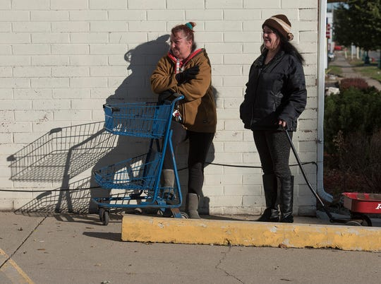 Charlene Misener and Sheri Duke wait for the food distribution to begin.