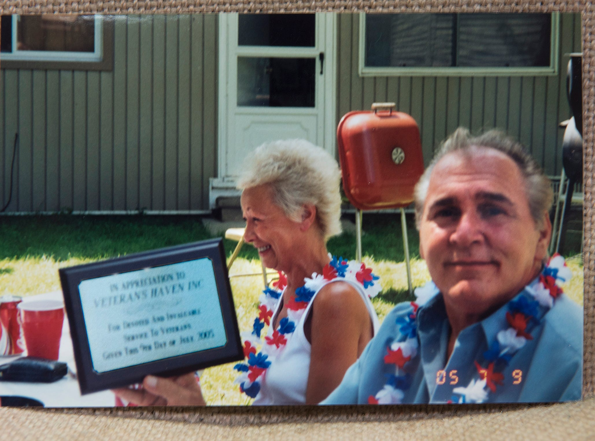 A family snapshot shows founder Vince Berna and his wife, Judy Berna, at a barbeque where they were honored for their efforts.