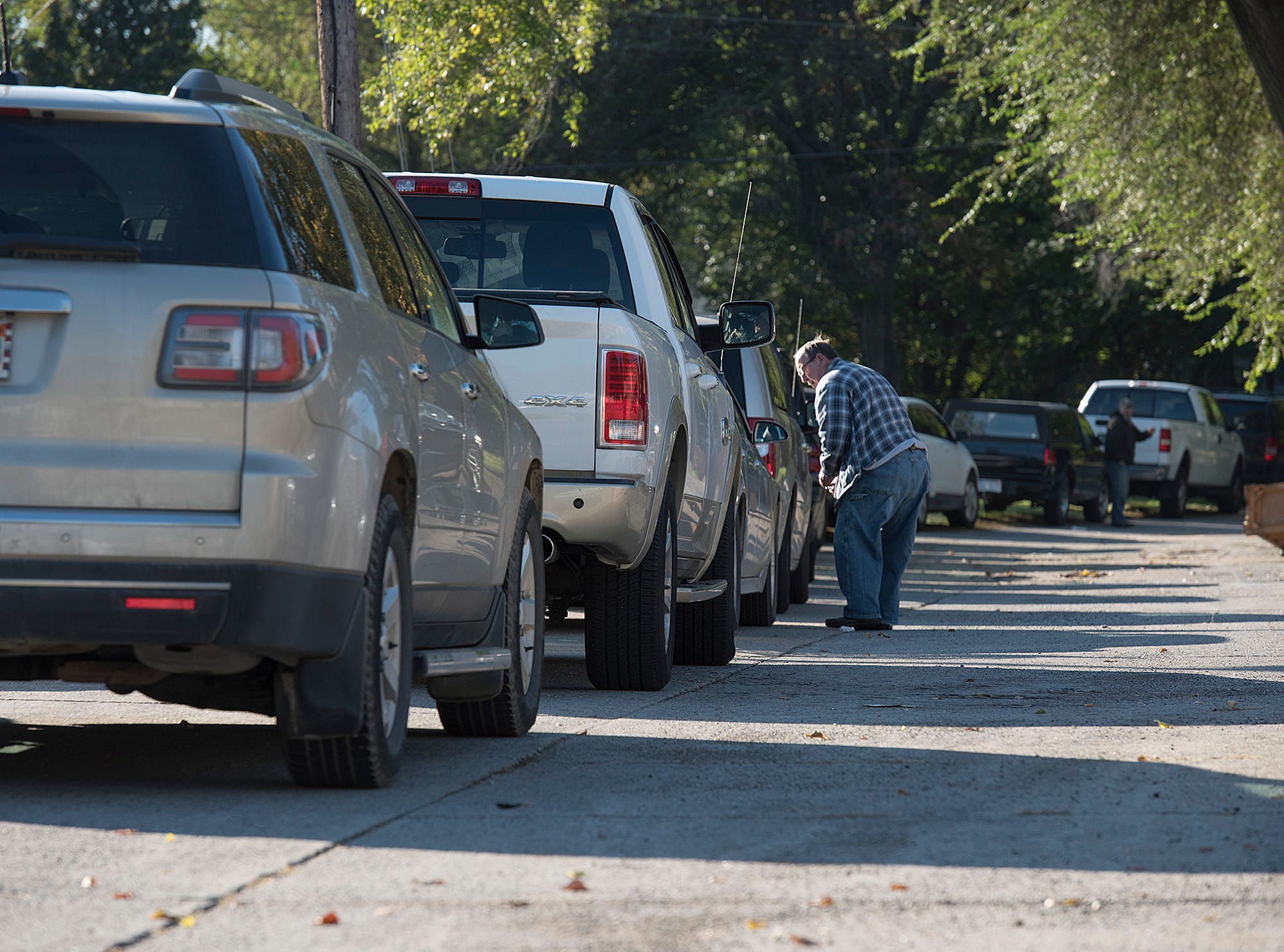 A long line of cars waits for veterans food distribution.