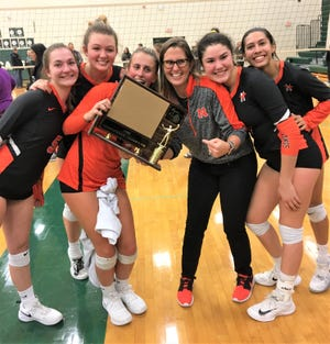 The Northville girls volleyball team celebrates after winning the KLAA tournament Oct. 20 at Novi.