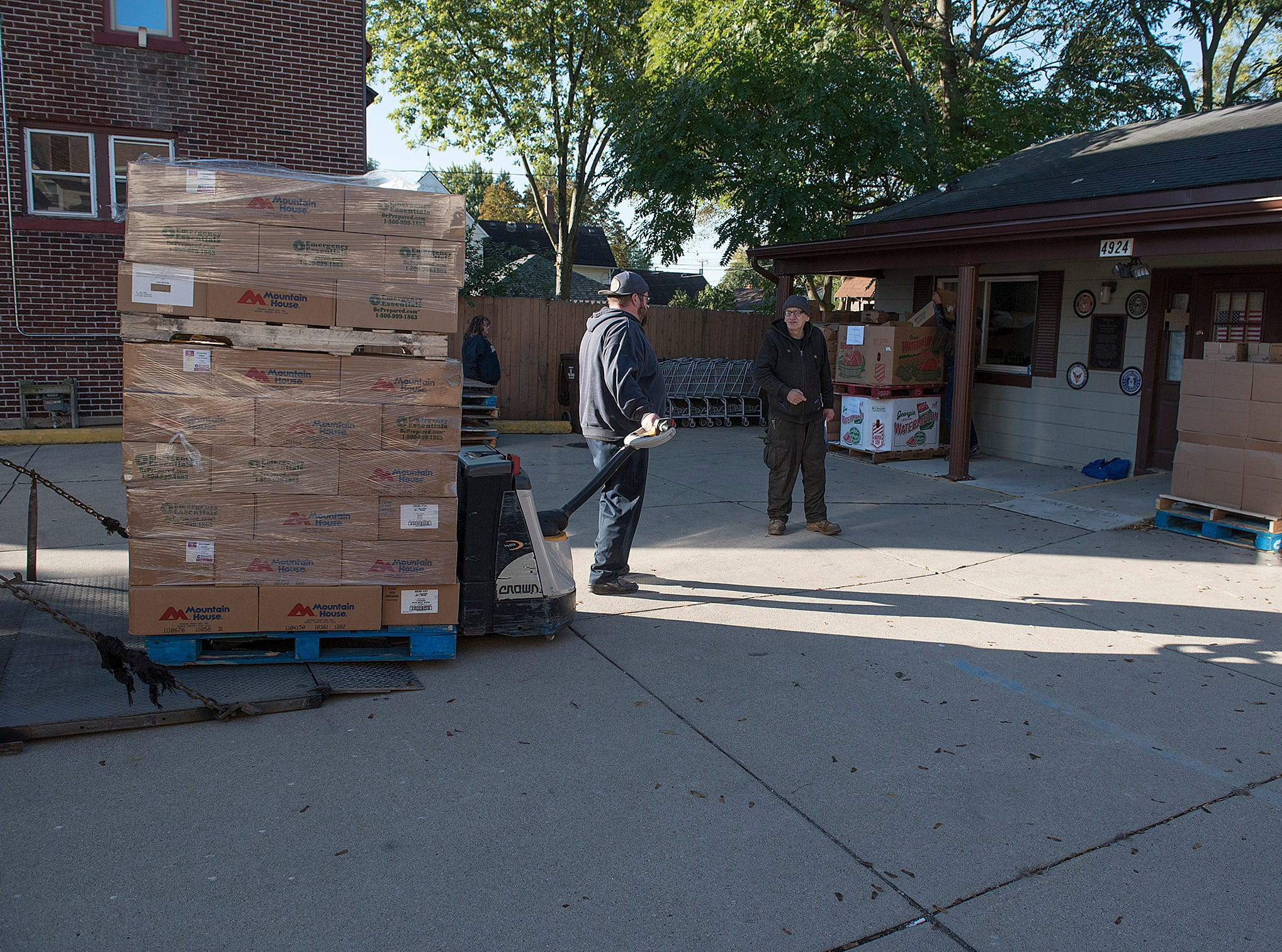 Early morning is the time that the truck from Gleaners arrives, with food for veterans.