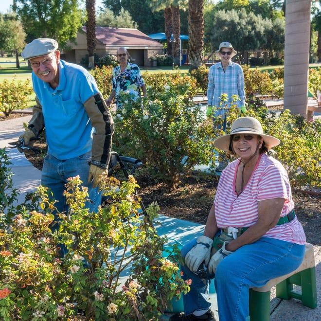 James and Matilde Jones in front with Glen Ezekieland Society president Linda Simmons enjoying the garden.