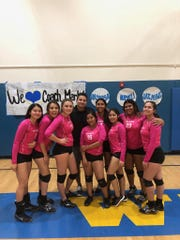 The West Shores volleyball team poses after a playoff win Wednesday. They are (from left to right) Fabiola Favela, Elizah Lopez, Alyssa Williams, coach Mark Ruiz, Nayeli Rivero, Cruzzanna Hernandez, Karen Ezpinoza, Jazmine Rodriguez and Stephanie Soto.