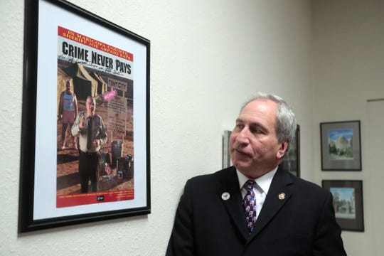 Republican Senator Jeff Stone, Pharm.D. Twenty-Eighth Senate District of the California Legislature with a sign photo of former Maricopa County, Arizona sheriff Joe Arpaio at his office in Indio on Thursday, October 25, 2018.