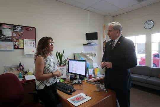 Republican Senator Jeff Stone, Pharm.D. Twenty-Eighth Senate District of the California Legislature talks to office assistant Josie Arechiga about scheduling at his office in Indio on Thursday, October 25, 2018.