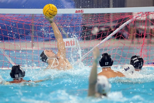 Xavier Prep keeper Justin Wickstrand makes a important save in the 4th quarter against La Quinta during the Desert Empire League water polo finals on Wednesday, October 24, 2018 at Cathedral City High School.