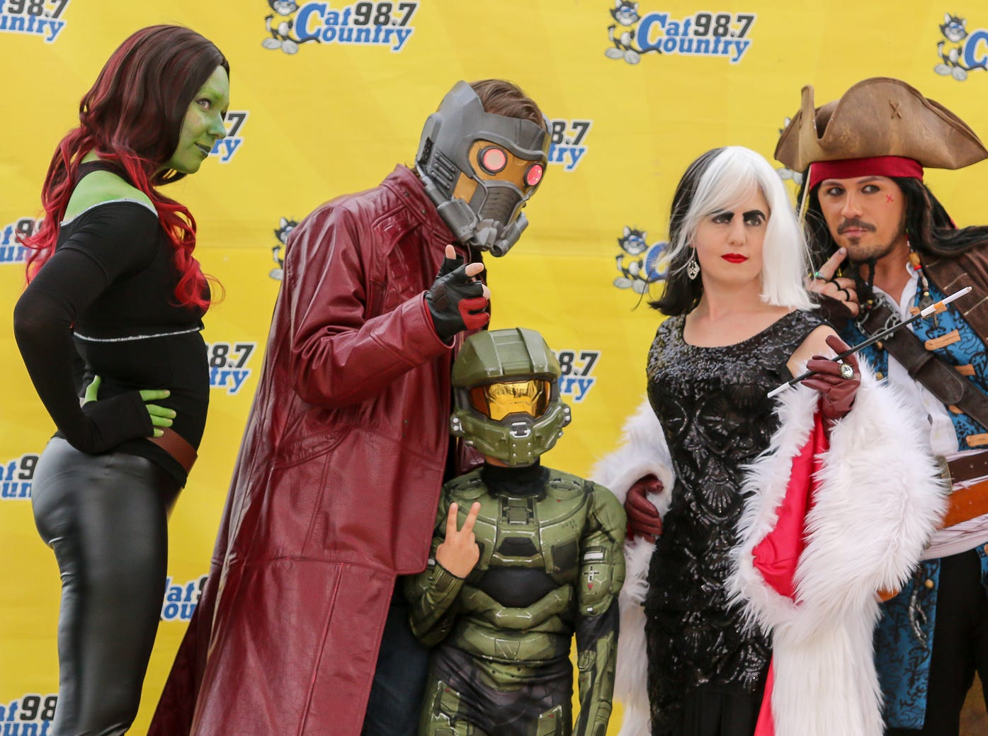 People have their picture taken with Pensacon cosplayers during the 84th annual Pensacola Interstate Fair on Monday, October 22, 2018.