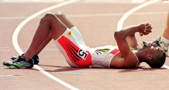 INDIANAPOLIS, UNITED STATES:  Mark Everett lies on his back after crossing the finish line to win the men's 800 meter run 14 June at the USA Track and Field Championships in Indianapolis. Everett won with a time of 1:44.37.  AFP PHOTO/Matt Campbell (Photo credit should read MATT CAMPBELL/AFP/Getty Images)
