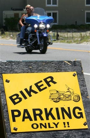 Bikers head into town for the annual spring Thunder Beach motorcycle rally in Panama City Beach on May 1, 2012.